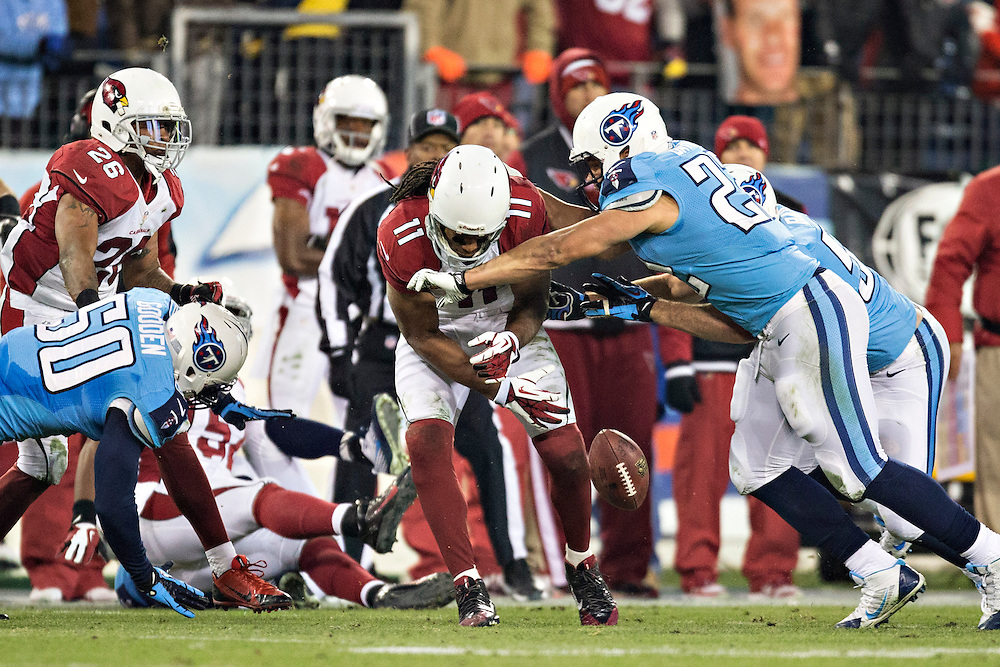 NASHVILLE, TN - DECEMBER 15:  Larry Fitzgerald #11 of the Arizona Cardinals jumps to get a on side kickoff but is hit and fumbles the ball by Jackie Battle #22 of the Tennessee Titans at LP Field on December 15, 2013 in Nashville, Tennessee.  The Cardinals defeated the Titans 37-34.  (Photo by Wesley Hitt/Getty Images) *** Local Caption *** Larry Fitzgerald; Jackie Battle