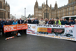 © licensed to London News Pictures. London, UK 07/03/2012. Members of FairFuel protest group is holding a banner as they are lobbying outside the Houses of the Parliaments after handing in their report to Downing Street. Photo credit: Tolga Akmen/LNP