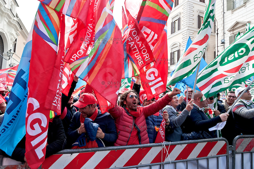 Eni Italian workers wave flags and shout slogans as they strike for a day and gather to take part in a demonstration to protest against the sell of Versalis, its synthetic rubber and chemicals company, in Rome, Italy. 19th Febraury 2016. The Italian energy and petrochemicals firm Eni is talking with investment fund SK Capital over the sale of a majority stake in its chemical unit. SK Capital is a private investment firm with a disciplined focus on the specialty materials, chemicals and healthcare sectors, headquartered in New York City.