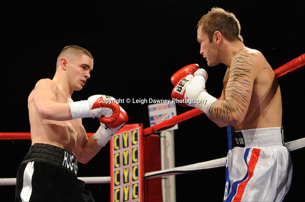 Joe Hughes (black shorts) defeats Gavin Putney at Brentwood Centre, Brentwood, Essex on the 5th February 2011. Frank Maloney Promotions. Photo credit © Leigh Dawney