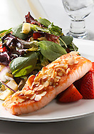 Salmon encrusted with almonds. Salad with spinach and mixed greens