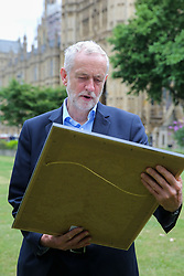 © London News Pictures. 27/06/2017. London, UK. Jeremy Corbyn with a framed copy of front page of Daily Mirror attends a Pride of Britain photocall in Westminster.  The Pride of Britain Awards honour British people who have acted bravely or extraordinarily in challenging situations. Photo credit: Dinendra Haria/LNP