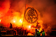 BSC Young Boys fans let off pyro flares before the Europa League Group G match between Rangers FC and BSC Young Boys at Ibrox Park, Glasgow, Scotland on 12 December 2019.