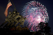 United States of America. Independence Day. July 4, 2005. Iwo Jima Memorial with fireworks exploding in background over Washington, DC, USA. Celebrations. American Flag. Soldiers.