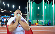 Joanna Fiodorow from Poland celebrates her bronze medal in women's hammer throw final during the Fourth Day of the European Athletics Championships Zurich 2014 at Letzigrund Stadium in Zurich, Switzerland.<br /> <br /> Switzerland, Zurich, August 15, 2014<br /> <br /> Picture also available in RAW (NEF) or TIFF format on special request.<br /> <br /> For editorial use only. Any commercial or promotional use requires permission.<br /> <br /> Photo by © Adam Nurkiewicz / Mediasport