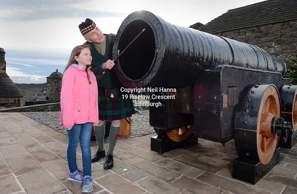 Edinburgh Castle Monday 23/05/2015<br /> <br /> MONS MEG RETURNS TO EDINBURGH CASTLE FOLLOWING MOT<br />  <br /> Mons Meg, the world&rsquo;s most famous medieval gun, was welcomed back to Edinburgh Castle this morning (23/03/15). The six tonne cannon has been undergoing specialist conservation work over the past two months at a secret location &ndash; the first time it has left the castle in over 30 years. Amongst the first visitors to inspect the works were Beth Graham, 9 from East Kilbride and Major Niall Archibald of The Royal Regiment of Scotland.<br /> <br />  Neil Hanna Photography<br /> www.neilhannaphotography.co.uk<br /> 07702 246823
