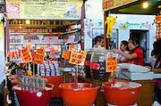 Spices, fried garlic, and moles for sale in the Mercado Benito Juarez, Oaxaca.