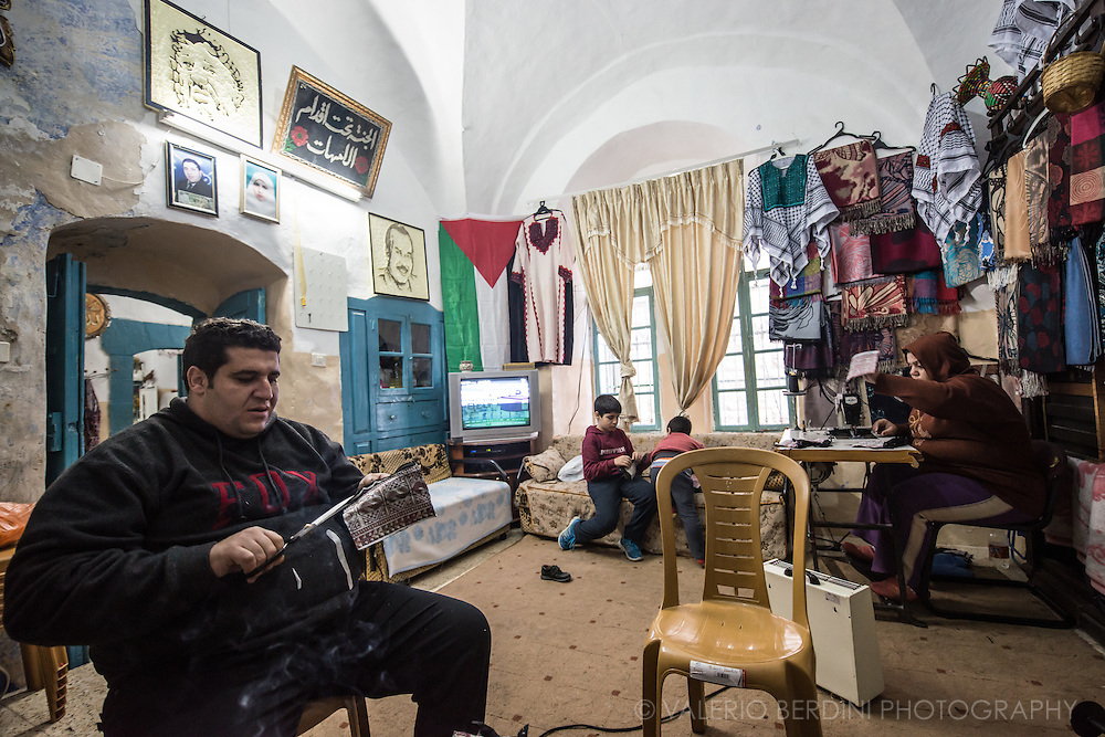 One of the few remaining Palestinian families living and working in a house bordering a settlement in area H2 of Hebron. People inhabiting this part of the city are constantly harassed by settlers. Children play inside because is not safe to play in the street.