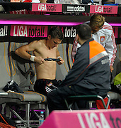 Bastian Schweinsteiger adjusts his heart monitor on the bench. Bayern Munich v Real Madrid, Allianz Arena, 13th August 2010