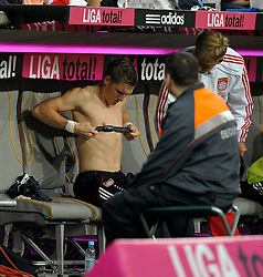 Bastian Schweinsteiger adjusts his heart monitor on the bench. Bayern Munich v Real Madrid, Allianz Arena, 13th August 2010