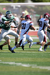 08 September 2012:  John Worley takes after runner Aaron Hahn during an NCAA division 3 football game between the Alma Scots and the Illinois Wesleyan Titans which the Titans won 53 - 7 in Tucci Stadium on Wilder Field, Bloomington IL