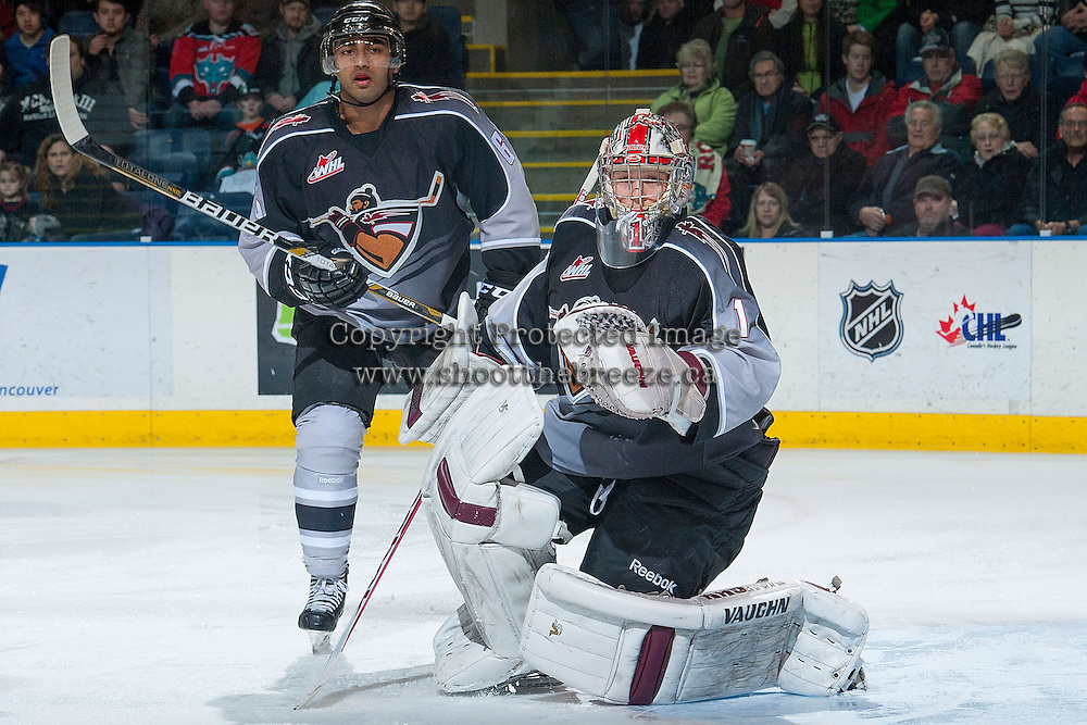 KELOWNA, CANADA - JANUARY 4: Arvin Atwal D #6 and Payton Lee #1 of the Vancouver Giants defend the net against the Kelowna Rockets on January 4, 2014 at Prospera Place in Kelowna, British Columbia, Canada.   (Photo by Marissa Baecker/Shoot the Breeze)  ***  Local Caption  ***