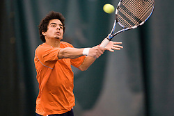 Sanam Singh in action against Texas.  The #1 ranked Virginia Cavaliers men's tennis team defeated the #5 ranked Texas Longhorns 5-2 at the Boyd Tinsley Courts at the Boar's Head Inn and Resort in Charlottesville, VA on February 29, 2008.