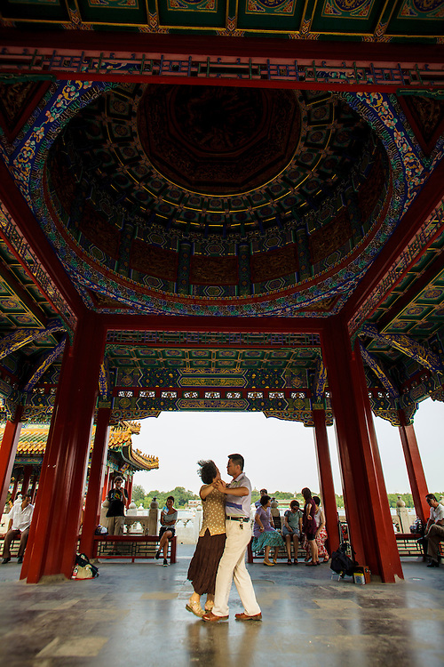 A couple dances in Behai Park in Beijing.