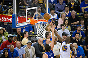 Golden State Warriors forward Draymond Green (23) stretches for a rebound against the Philadelphia 76ers at Oracle Arena in Oakland, Calif., on March 14, 2017. (Stan Olszewski/Special to S.F. Examiner)