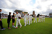 The Somerset players with Marcus Trescothick at the front walk from the field after their victory over Nottinghamshire in the Specsavers County Champ Div 1 match between Somerset County Cricket Club and Nottinghamshire County Cricket Club at the Cooper Associates County Ground, Taunton, United Kingdom on 22 September 2016. Photo by Graham Hunt.