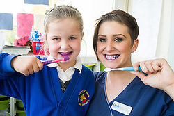 Oasis Lead Dental Nurse Mel Brown with Gracie after using  disclosure tablets to reveal plaque in the mouth during an oral hygiene session at  Hunloke Park Primary School Wingerworth Chesterfield on Tuesday<br /> 20 October 2015<br />  Image &copy; Paul David Drabble <br />  www.pauldaviddrabble.co.uk
