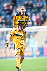 Dumbarton's Garry Fleming (bottom) celebrates after scoring their first goal.<br /> Falkirk 1 v 2 Dumbarton, Scottish Championship game played today at the Falkirk Stadium.<br /> &copy;Michael Schofield.