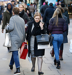 "© Licensed to London News Pictures. 25/11/2016. London, UK. Shoppers head out early to grab bargains on Oxford Street, central London on ""Black Friday"". Sales from this years Black Friday event are expected to top £2 billion. Photo credit: Tolga Akmen/LNP"