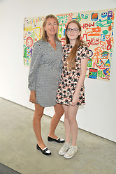 TIGGY KENNEDY and her daughter STELLA KENNEDY at a lunch in aid of the charity African Solutions to African Problems (ASAP) held at the Louise T Blouin Foundation, 3 Olaf Street, London W11 on 21st May 2014.