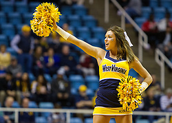 Jan 7, 2017; Morgantown, WV, USA; A West Virginia Mountaineers cheerleader performs before their game against the TCU Horned Frogs at WVU Coliseum. Mandatory Credit: Ben Queen-USA TODAY Sports