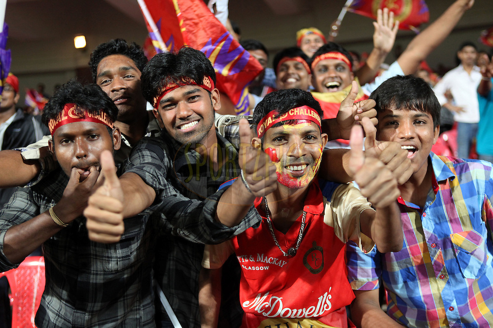 Fans enjoy the CLT20 atmosphere during match 16 of the NOKIA Champions League T20 ( CLT20 ) between the Royal Challengers Bangalore and Somerset held at the  M.Chinnaswamy Stadium in Bangalore , Karnataka, India on the 3rd October 2011..Photo by Ron Gaunt/BCCI/SPORTZPICS
