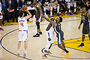 Golden State Warriors guard Quinn Cook (4) shoots a jumper as Golden State Warriors guard Nick Young (6) is stuck behind a screen at Oracle Arena in Oakland, California, on February 22, 2018. (Stan Olszewski/Special to S.F. Examiner)