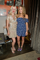 Left to right, HARRIET VERNEY and CHELSEA LEYLAND at the Creme de la Mer Blue Marine Foundation Dinner held at The Arts Club, 40 Dover Street, London on 23rd June 2015.