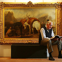 Sothebys Auction at Gleneagles...<br /> One of the highlights of this years sale is 'The Halt' by John Frederick Herring dated 1852 and shows a party of two highlanders, their ponies and a pair of deerhounds pausing by a burn...The painting is expected to reach in excess of &pound;300,000 - &pound;500,000, Pictured with the painting is Sotheby's Scottish Director Harry Robertson<br /> Picture by Graeme Hart.<br /> Copyright Perthshire Picture Agency