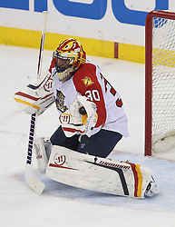 April 24, 2012; Newark, NJ, USA; Florida Panthers goalie Scott Clemmensen (30) makes a glove save during the first period of game six of the 2012 Eastern Conference quarterfinals at the Prudential Center.