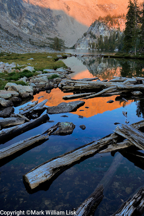 Sunrise reflects into the small outlet at Island Lake, White Cloud Wilderness.
