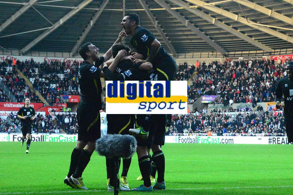 Football - 2012 / 2013 Premier League - Swansea vs. Norwich City_grant holt scores norwich's 3rd goal, russel martyn leaps to celebrate.
