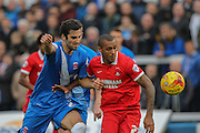 Leyton Orient forward Jay Simpson  and Hartlepool United defender Carl Magnay  during the Sky Bet League 2 match between Hartlepool United and Leyton Orient at Victoria Park, Hartlepool, England on 15 November 2015. Photo by Simon Davies.