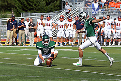 01 October 2016:  Brandon Bauer holds for extra point kicker Andrew Iwaszkiewicz during an NCAA division 3 football game between the Wheaton Thunder and the Illinois Wesleyan Titans in Tucci Stadium on Wilder Field, Bloomington IL (Photo by Alan Look)