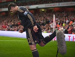 LONDON, ENGLAND - Wednesday, October 28, 2009: Liverpool's Emiliano Insua kicks away a television effects microphone during the League Cup 4th Round match at Emirates Stadium. (Photo by David Rawcliffe/Propaganda)
