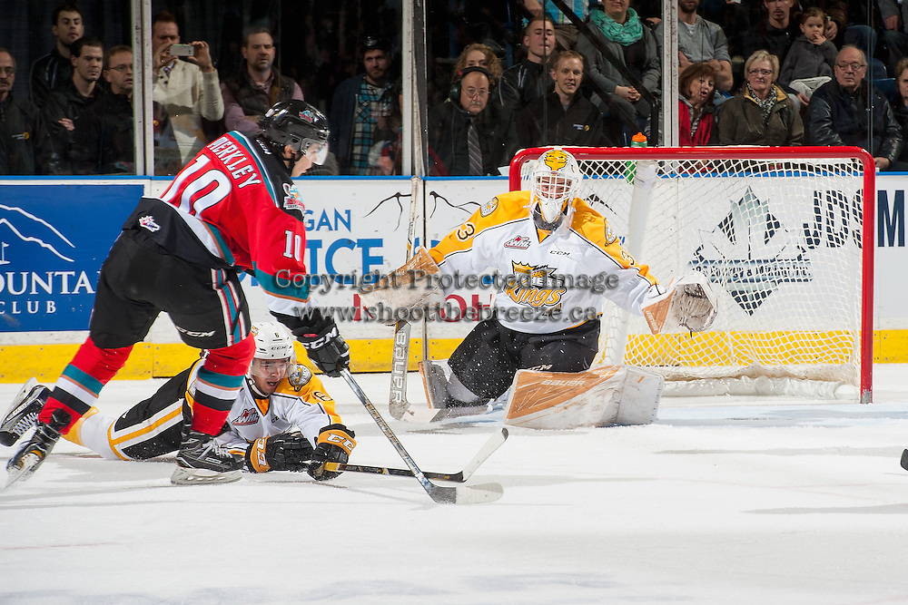 KELOWNA, CANADA - DECEMBER 3: Jordan Papirny #33 of the Brandon Wheat Kings defends the net against a shot by Nick Merkley #10 of the Kelowna Rockets during first period on December 3, 2016 at Prospera Place in Kelowna, British Columbia, Canada.  (Photo by Marissa Baecker/Shoot the Breeze)  *** Local Caption *** Jordan Papirny; Nick Merkley;