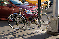 Women's Bicycle chained to signpost in Midtown Manhattan New York