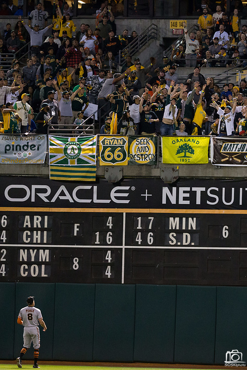 San Francisco Giants right fielder Hunter Pence (8) watches as a Oakland Athletics home run leaves right field at Oakland Coliseum in Oakland, California, on August 1, 2017. (Stan Olszewski/Special to S.F. Examiner)