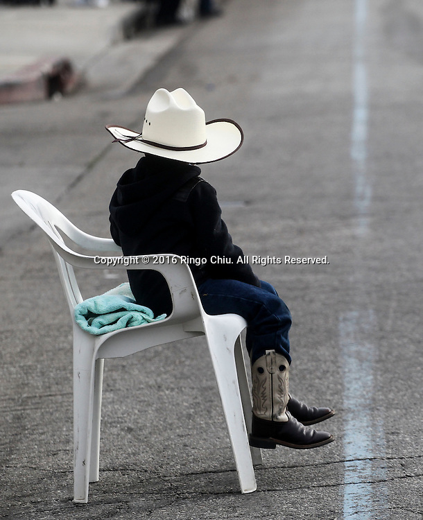 A young boy waits as the Martin Luther King Jr. parade makes it's way down Martin Luther King Blvd. in Los Angeles on Monday Jan. 18, 2016. The 31st annual Kingdom Day Parade honoring Martin Luther King Jr. was themed &quot;Our Work Is Not Yet Done&quot;(Photo by Ringo Chiu/PHOTOFORMULA.com)<br /> <br /> Usage Notes: This content is intended for editorial use only. For other uses, additional clearances may be required.