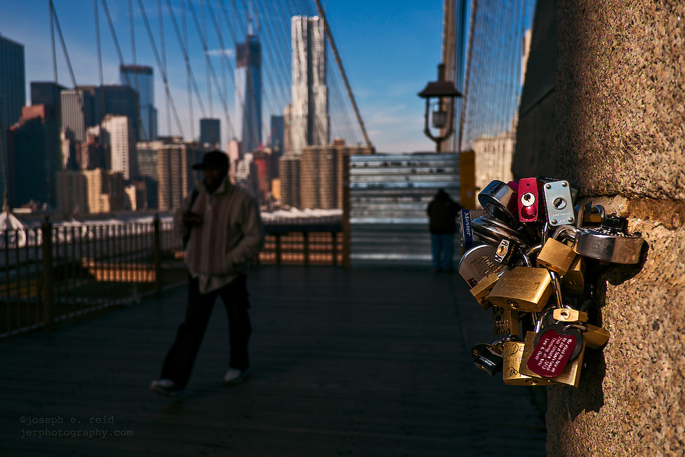 Padlocks left by tourists on the Brooklyn Bridge as signs of love