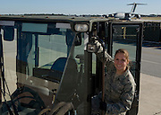 Senior Airman Kelly Ashley stands on a forklift at the 437th Aerial Port Squadron at Charleston Air Force Base, S.C., on Oct. 30, 2008.