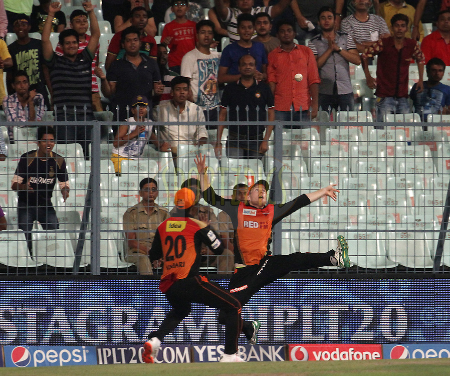 Sunrisers Hyderabad player Eoin Morgan dives to take a catch during match 38 of the Pepsi IPL 2015 (Indian Premier League) between The Kolkata Knight Riders and The Sunrisers Hyderabad held at Eden Gardens Stadium in Kolkata, India on the 4th May 2015.<br /> <br /> Photo by:  Vipin Pawar / SPORTZPICS / IPL