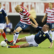 May 26 2012: Scotland's Scott Brown (8) slide tackles USA's Michael Bradley (4) during the first half of play of the U.S. Men's National Soccer Team game against Scotland at Everbank Field in Jacksonville, FL. At halftime USA lead Scotland 2-1.