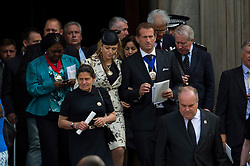 © Licensed to London News Pictures. 07/07/2015. London, UK. Guests leaving the service. . A church service held at St Paul's Cathedral In London on the 10th anniversary of the 7/7 bombings in London which killed 52 civilians and injured over 700 more.  Photo credit: Ben Cawthra/LNP