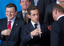 Nicolas Sarkozy, France's president, center, speaks with Donald Tusk, Poland's prime minister, right, as Jose Manuel, Barroso, president of the European Commission, left, and Lawrence Gonzi, Malta's prime minister, back left, look on, during the European Summit, in Brussels, on Thursday, March 25, 2010. (Photo © Jock Fistick)