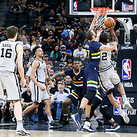 02 April 2017: San Antonio Spurs forward Kawhi Leonard (2) goes for the layup against Utah Jazz center Rudy Gobert (27) during the San Antonio Spurs 109-103 victory over the Utah Jazz, at the AT&T Center, San Antonio, Texas, USA.