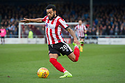 Lincoln City Midfielder Nathan Arnold crosses the ball into the box during the EFL Sky Bet League 2 match between Lincoln City and Coventry City at Sincil Bank, Lincoln, United Kingdom on 18 November 2017. Photo by Craig Zadoroznyj.