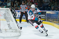 KELOWNA, CANADA - DECEMBER 30:  Myles Bell #29 of the Kelowna Rockets skates behind the net against the Everett Silvertips at the Kelowna Rockets on December 30, 2012 at Prospera Place in Kelowna, British Columbia, Canada (Photo by Marissa Baecker/Shoot the Breeze) *** Local Caption ***