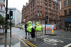 © Licensed to London News Pictures . 30/09/2017. Manchester, UK.  Police and security outside the Midland Hotel as Manchester prepares for the Conservative Party Conference , which is taking place inside a secured zone around the Manchester Central Convention Centre . Photo credit: Joel Goodman/LNP