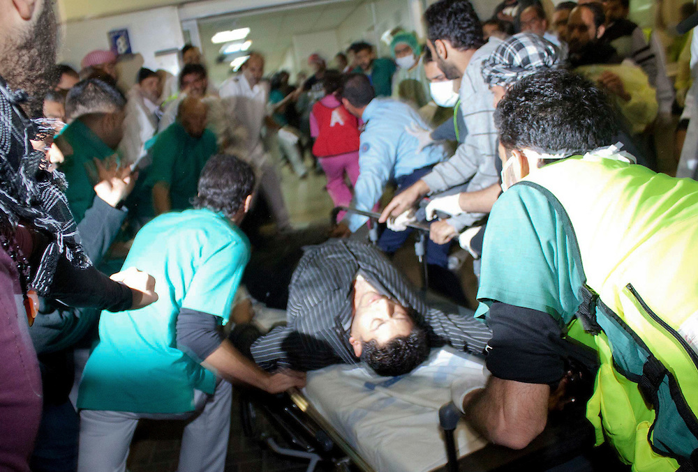 Protesters are rushed into Salmaniya Hospital Complex in Manama, Bahrain to be treated after being shot at by security forces.